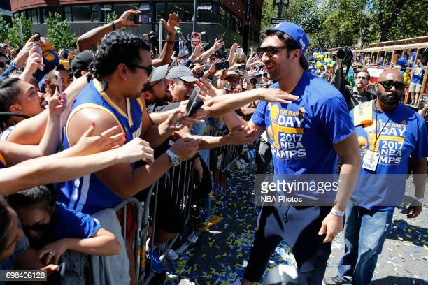 Zaza Pachulia of the Golden State Warriors interacts with fans during the Victory Parade and Rally on June 15 2017 in Oakland California at The Henry...