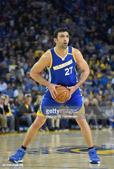 Zaza Pachulia of the Golden State Warriors looks to pass the ball against the Phoenix Suns during an NBA basketball game at ORACLE Arena on November...
