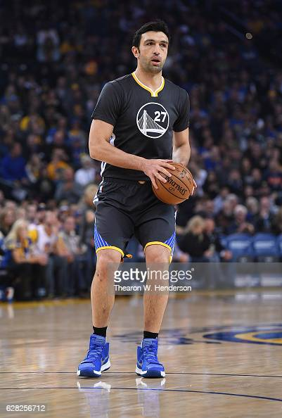 Zaza Pachulia of the Golden State Warriors looks to pass the ball against the Phoenix Suns Suns during an NBA basketball game at ORACLE Arena on...