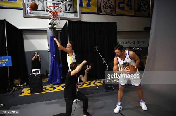 Zaza Pachulia of the Golden State Warriors poses for a portrait while Klay Thompson shoots baskets during the Golden States Warriors media day at...