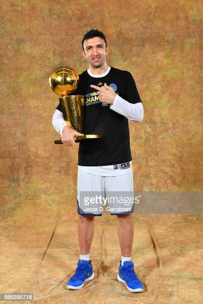 Zaza Pachulia of the Golden State Warriors poses for a portrait with the Larry O'Brien Trophy after defeating the Cleveland Cavaliers in Game Five of...