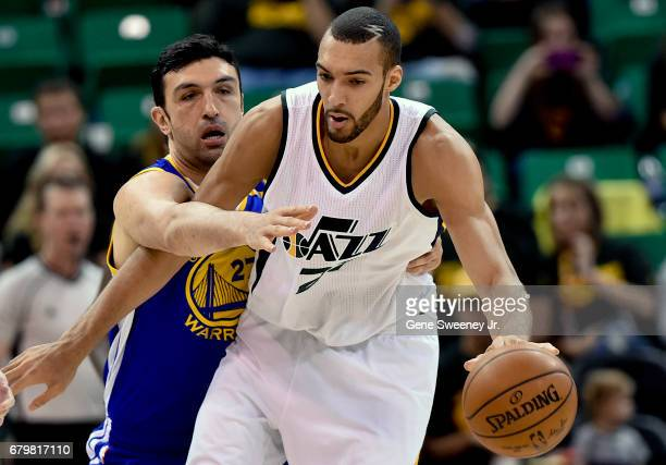 Zaza Pachulia of the Golden State Warriors reaches in on Rudy Gobert of the Utah Jazz in the second half of the Warriors' 10291 win in Game Three of...