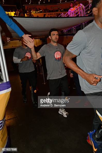 Zaza Pachulia of the Golden State Warriors shakes fans hands as he runs on the court before the game against the Los Angeles Lakers on November 4...