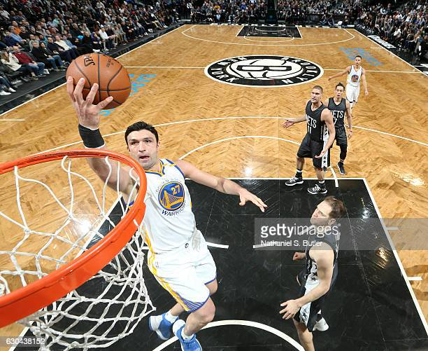 Zaza Pachulia of the Golden State Warriors shoots during a game against the Brooklyn Nets on December 22 2016 at Barclays Center in Brooklyn NY NOTE...