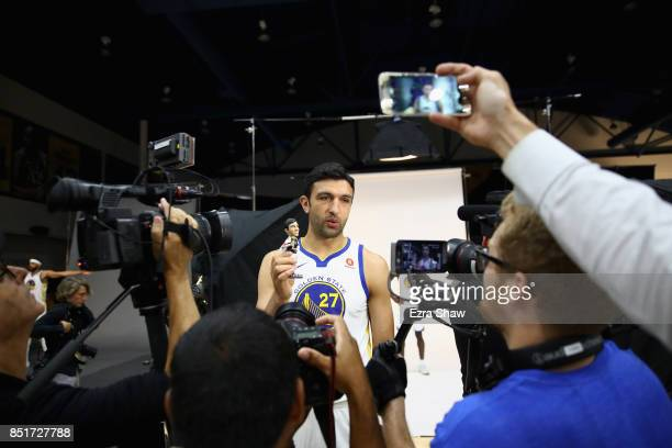 Zaza Pachulia of the Golden State Warriors shows off his new bobble head doll during the Golden States Warriors media day at Rakuten Performance...