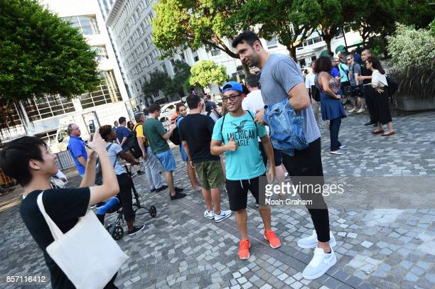 Zaza Pachulia of the Golden State Warriors takes some photos with a fan around Hong Kong as part of the 2017 Global Games China on October 3 2017 in...