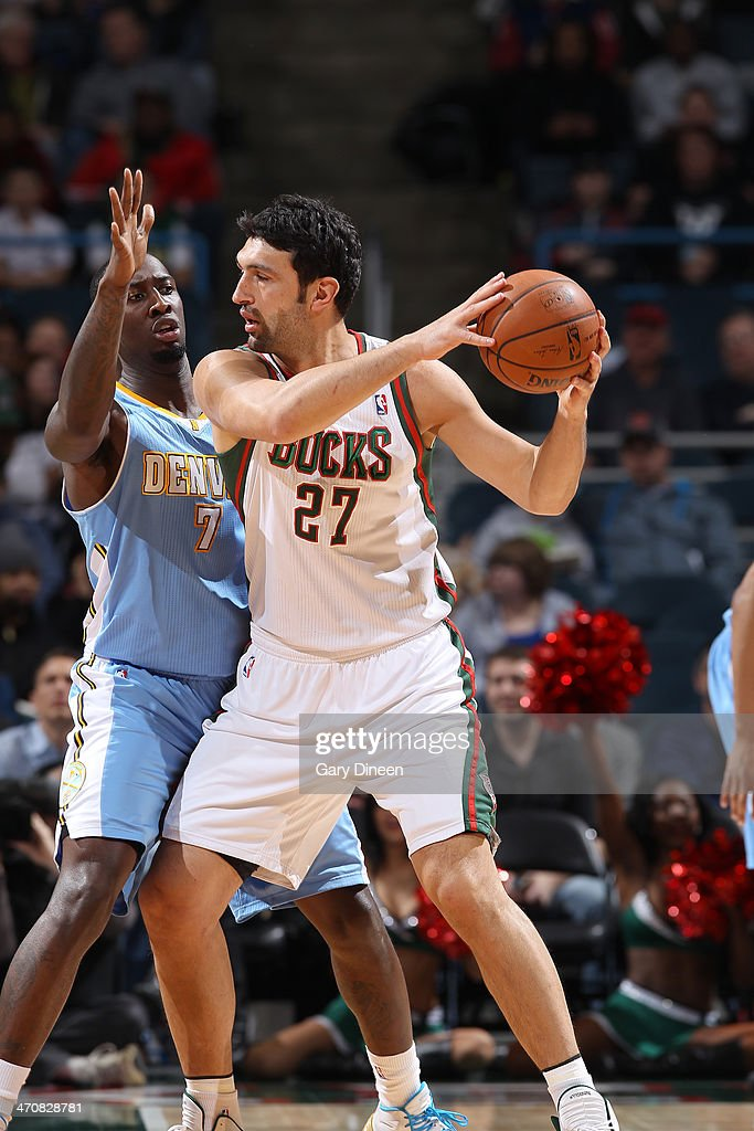 Zaza Pachulia #27 of the Milwaukee Bucks controls the ball against J.J. Hickson #7 of the Denver Nuggets on February 20, 2014 at the BMO Harris Bradley Center in Milwaukee, Wisconsin.