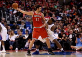 Zaza Pachulia of the Milwaukee Bucks cpontrols the ball against Glen Davis of the Los Angeles Clippers at Staples Center on March 24 2014 in Los...