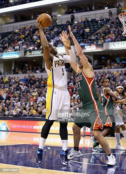 Zaza Pachulia of the Milwaukee Bucks defends Lavoy Allen of the Indiana Pacers during the game at Bankers Life Fieldhouse on November 4 2014 in...