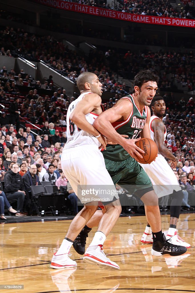 Zaza Pachulia #27 of the Milwaukee Bucks drives to the basket against the Portland Trail Blazersl on March 18, 2014 at the Moda Center Arena in Portland, Oregon.