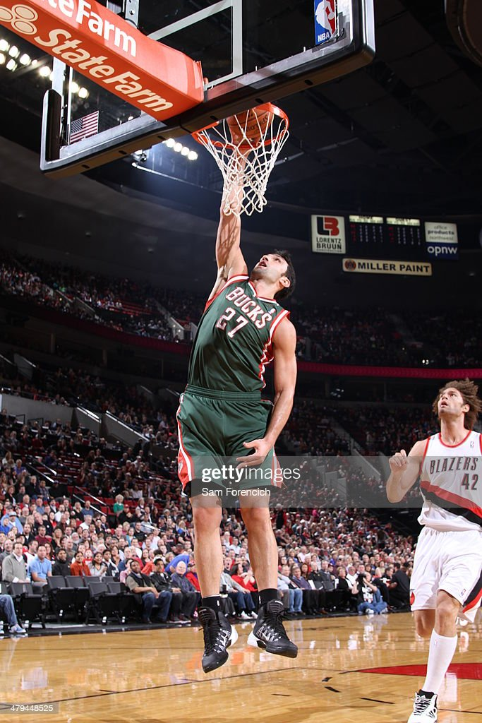 Zaza Pachulia #27 of the Milwaukee Bucks dunks against the Portland Trail Blazersl on March 18, 2014 at the Moda Center Arena in Portland, Oregon.