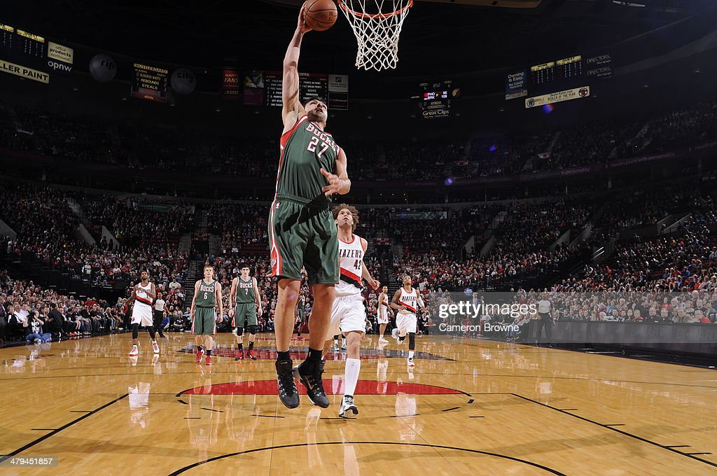 Zaza Pachulia #27 of the Milwaukee Bucks dunks against the Portland Trail Blazers on March 18, 2014 at the Moda Center Arena in Portland, Oregon.