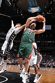Zaza Pachulia of the Milwaukee Bucks grabs a rebound against Brook Lopez of the Brooklyn Nets on March 20 2015 at Barclays Center in Brooklyn New...