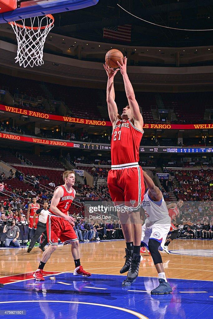 Zaza Pachulia #27 of the Milwaukee Bucks grabs a rebound against the Philadelphia 76ers on February 24, 2014 at the Wells Fargo Center in Philadelphia, Pennsylvania.