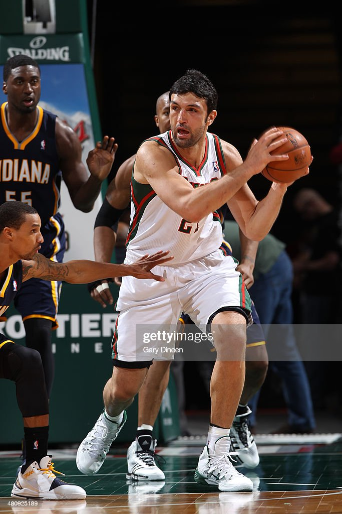 <a gi-track='captionPersonalityLinkClicked' href=/galleries/search?phrase=Zaza+Pachulia&family=editorial&specificpeople=202939 ng-click='$event.stopPropagation()'>Zaza Pachulia</a> #27 of the Milwaukee Bucks looks to pass the ball against the Indiana Pacers on February 22, 2014 at the BMO Harris Bradley Center in Milwaukee, Wisconsin.