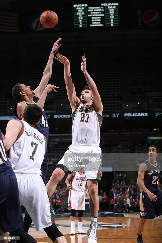 Zaza Pachulia #27 of the Milwaukee Bucks shoots against Alexis Ajinca #42 of the New Orleans Pelicans on February 12, 2014 at the BMO Harris Bradley Center in Milwaukee, Wisconsin.