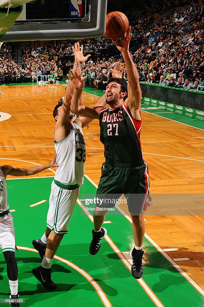 Zaza Pachulia #27 of the Milwaukee Bucks shoots against the Boston Celtics on December 3, 2013 at the TD Garden in Boston, Massachusetts.