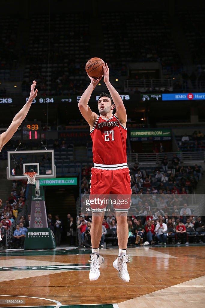 Zaza Pachulia #27 of the Milwaukee Bucks shoots against the Houston Rockets on February 8, 2014 at the BMO Harris Bradley Center in Milwaukee, Wisconsin.