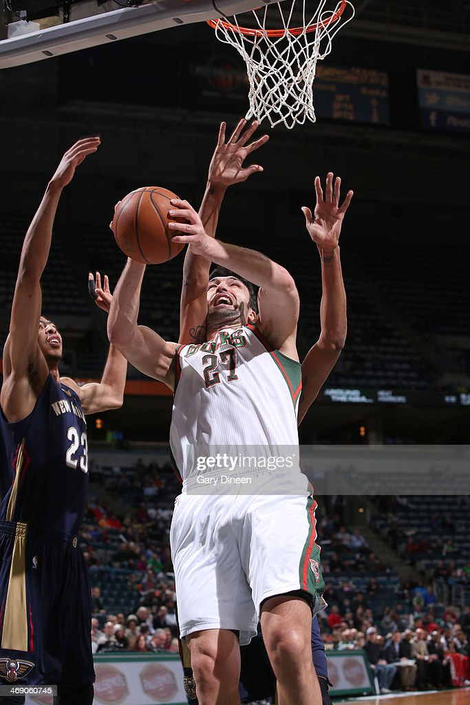 Zaza Pachulia #27 of the Milwaukee Bucks shoots against the New Orleans Pelicans on February 12, 2014 at the BMO Harris Bradley Center in Milwaukee, Wisconsin.