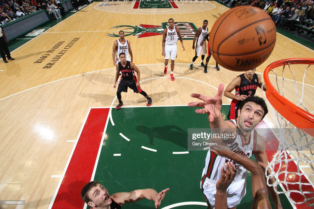 <a gi-track='captionPersonalityLinkClicked' href=/galleries/search?phrase=Zaza+Pachulia&family=editorial&specificpeople=202939 ng-click='$event.stopPropagation()'>Zaza Pachulia</a> #27 of the Milwaukee Bucks shoots against the Toronto Raptors on November 2, 2013 at the BMO Harris Bradley Center in Milwaukee, Wisconsin.