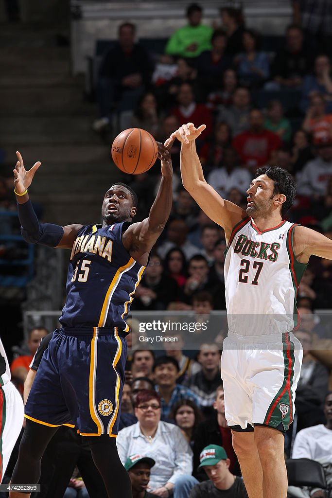 Zaza Pachulia #27 of the Milwaukee Bucks steals the ball from Roy Hibbert #55 of the Indiana Pacers on February 22, 2014 at the BMO Harris Bradley Center in Milwaukee, Wisconsin.