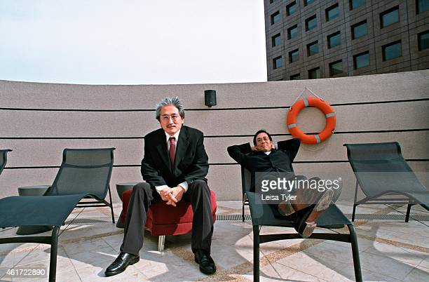 Zazuo Furukawa flamboyant Japanese designer of the Waterfloor Spa at the M Hotel in Singapore and the General Manager Malvin Lim on the rooftop pool...