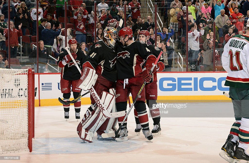 <a gi-track='captionPersonalityLinkClicked' href=/galleries/search?phrase=Zbynek+Michalek&family=editorial&specificpeople=243230 ng-click='$event.stopPropagation()'>Zbynek Michalek</a> #4 of the Phoenix Coyotes congratulates goalie Mike Smith #41 following their 2-1 victory over the Minnesota Wild at Jobing.com Arena on February 4, 2013 in Glendale, Arizona.