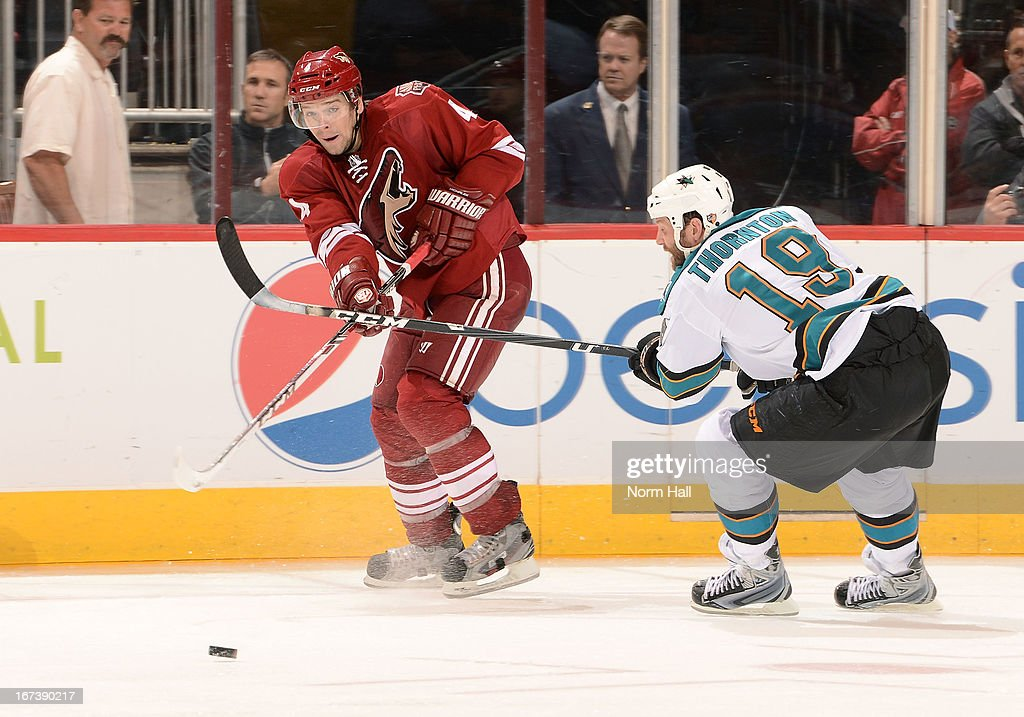 <a gi-track='captionPersonalityLinkClicked' href=/galleries/search?phrase=Zbynek+Michalek&family=editorial&specificpeople=243230 ng-click='$event.stopPropagation()'>Zbynek Michalek</a> #4 of the Phoenix Coyotes passes the puck as <a gi-track='captionPersonalityLinkClicked' href=/galleries/search?phrase=Joe+Thornton&family=editorial&specificpeople=201829 ng-click='$event.stopPropagation()'>Joe Thornton</a> #19 of the San Jose Sharks pressures during the third period at Jobing.com Arena on April 24, 2013 in Glendale, Arizona.