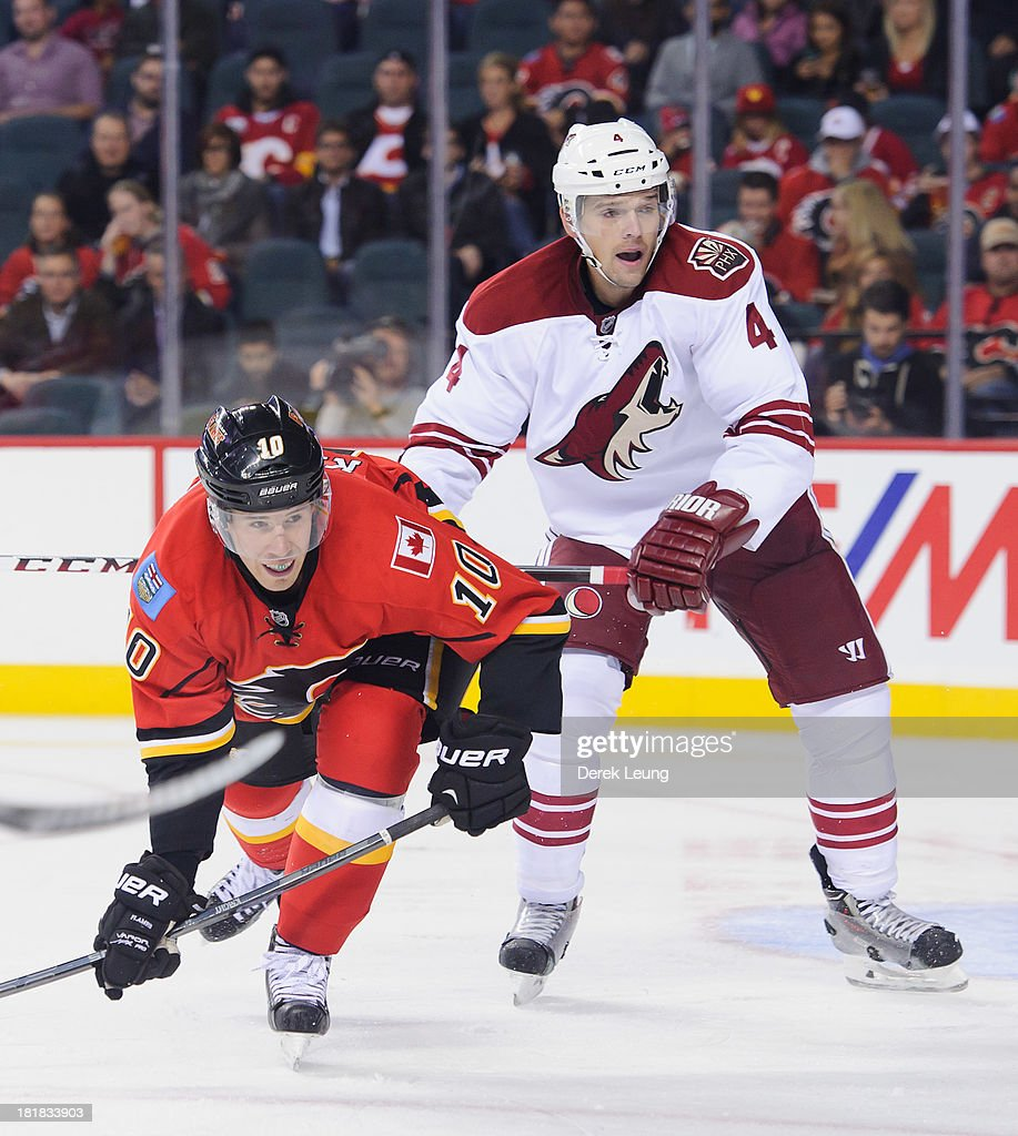 <a gi-track='captionPersonalityLinkClicked' href=/galleries/search?phrase=Zbynek+Michalek&family=editorial&specificpeople=243230 ng-click='$event.stopPropagation()'>Zbynek Michalek</a> #4 of the Phoenix Coyotes shoves Corban Knight #10 of the Calgary Flames in front of the Coyote's net during a preseason NHL game at Scotiabank Saddledome on September 25, 2013 in Calgary, Alberta, Canada.