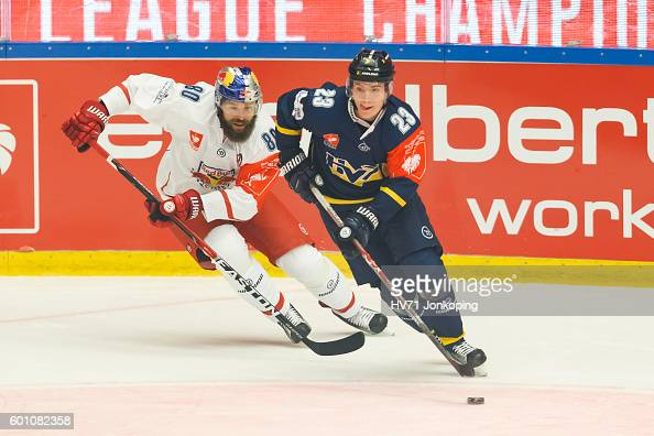Zdenek Kutlak of Red Bull Salzburg chasing Lias Andersson of HV71 who has the puck during the Champions Hockey League match between HV71 Jonkoping...