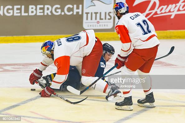 Zdenek Kutlak of Red Bull Salzburg lays over Filip Sandberg of HV71 focusing on the puck during the Champions Hockey League match between HV71...