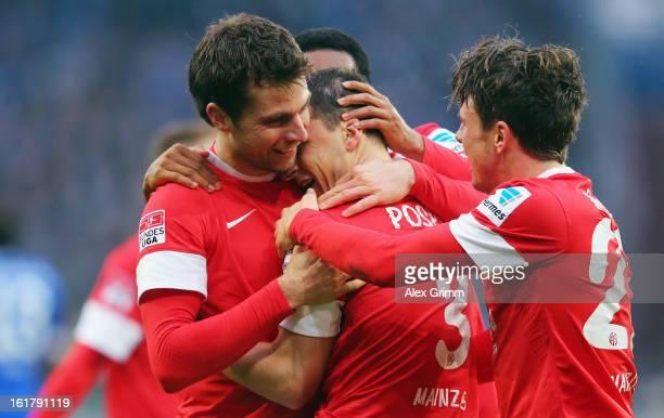 Zdenek Pospech of Mainz celebrates his team's second goal with team mates Andreas Ivanschitz and Nicolai Mueller during the Bundesliga match between...
