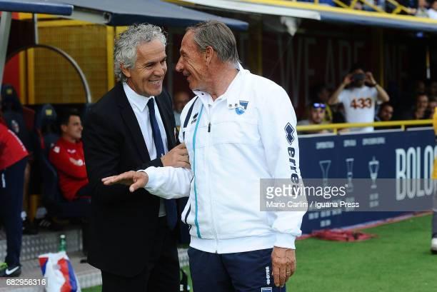Zdenek Zeman head coach of Pescara Calcio talks with Roberto Donadoni head coach of Bologna FC during the Serie A match between Bologna FC and...