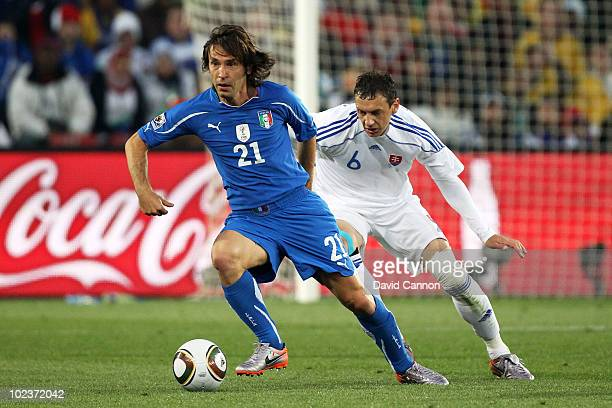Zdenko Strba of Slovakia pursues Andrea Pirlo of Italy during the 2010 FIFA World Cup South Africa Group F match between Slovakia and Italy at Ellis...