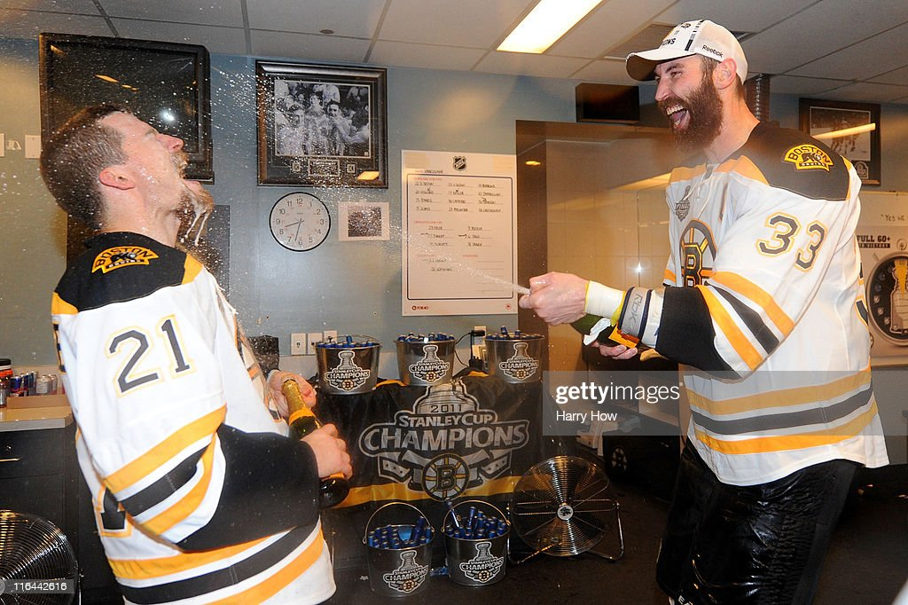 Zdeno Chara and Andrew Ference of the Boston Bruins celebrate in the locker room after defeating the Vancouver Canucks in Game Seven of the 2011 NHL...