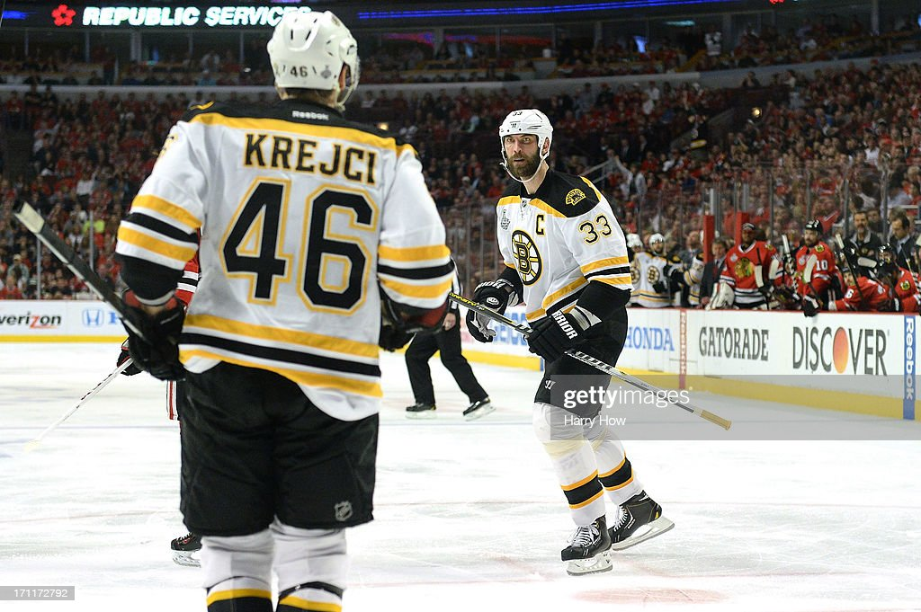 Zdeno Chara and David Krejci of the Boston Bruins celebrate after CHara scored a goal in the third period against the Chicago Blackhawks in Game Five...