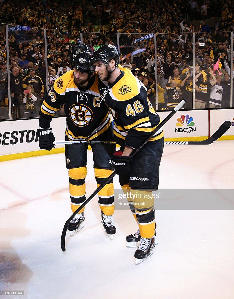 Zdeno Chara #33 and David Krejci #46 of the Boston Bruins celebrate after defeating the Pittsburgh Penguins 1-0 in Game Four of the Eastern Conference Final during the 2013 NHL Stanley Cup Playoffs at the TD Garden on June 7, 2013 in Boston, United States.