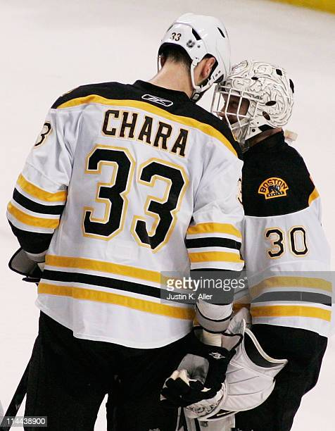 Zdeno Chara and Tim Thomas of the Boston Bruins celebrate defeating the Tampa Bay Lightning 2 to 0 in Game Three of the Eastern Conference Finals...