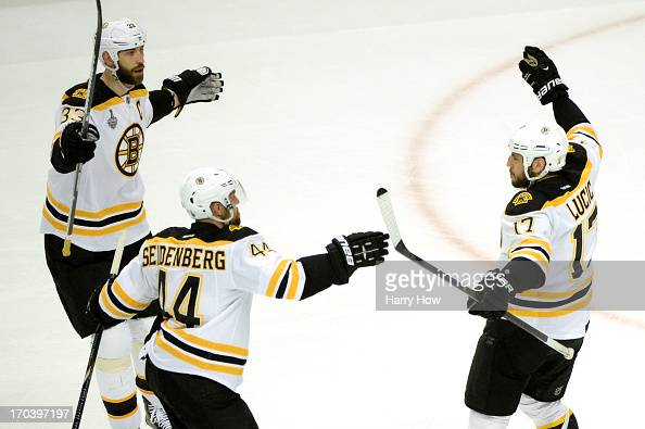 Zdeno Chara Dennis Seidenberg and Milan Lucic of the Boston Bruins celebrate after Lucic scored a first period goal against the Chicago Blackhawks in...