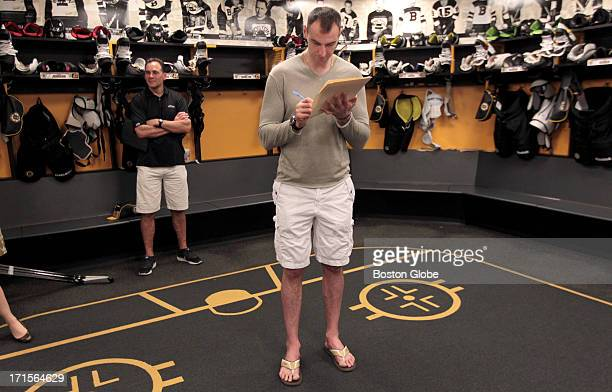 Zdeno Chara does some endofseason paperwork The Boston Bruins in their locker room at the end of the season after Monday's Game Six loss to the...