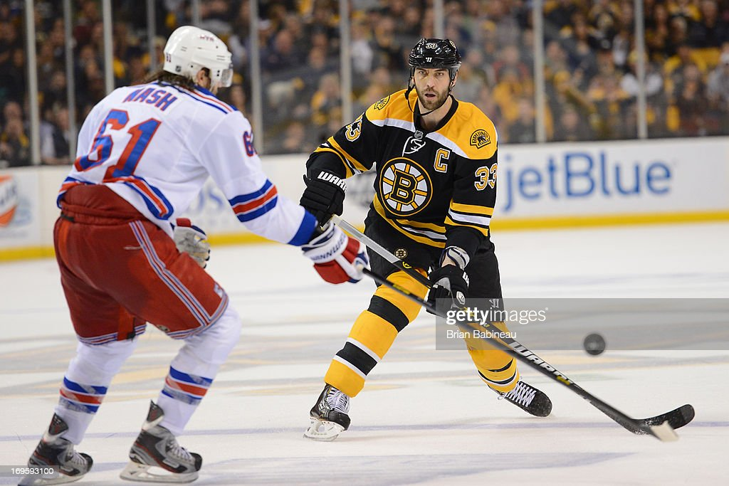 Zdeno Chara #33 of the Boston Bruins against Rick Nash #61 of the New York Rangers in Game Five of the Eastern Conference Semifinals during the 2013 NHL Stanley Cup Playoffs at TD Garden on May 25, 2013 in Boston, Massachusetts.