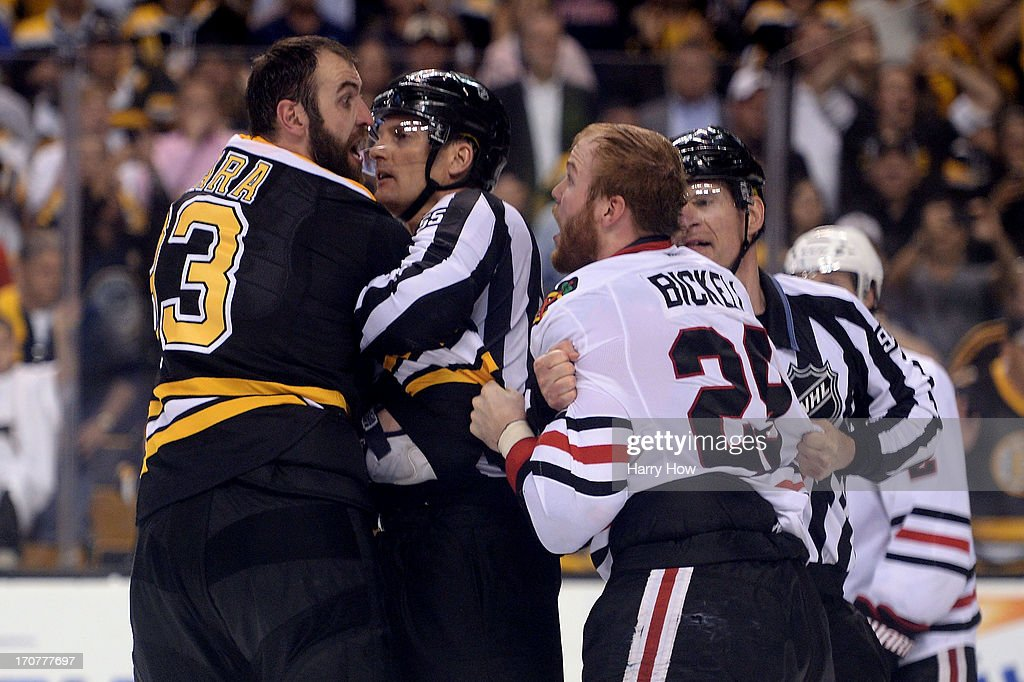 Zdeno Chara #33 of the Boston Bruins and Bryan Bickell #29 of the Chicago Blackhawks are seperated by officials late in Game Three of the 2013 NHL Stanley Cup Final at TD Garden on June 17, 2013 in Boston, Massachusetts.