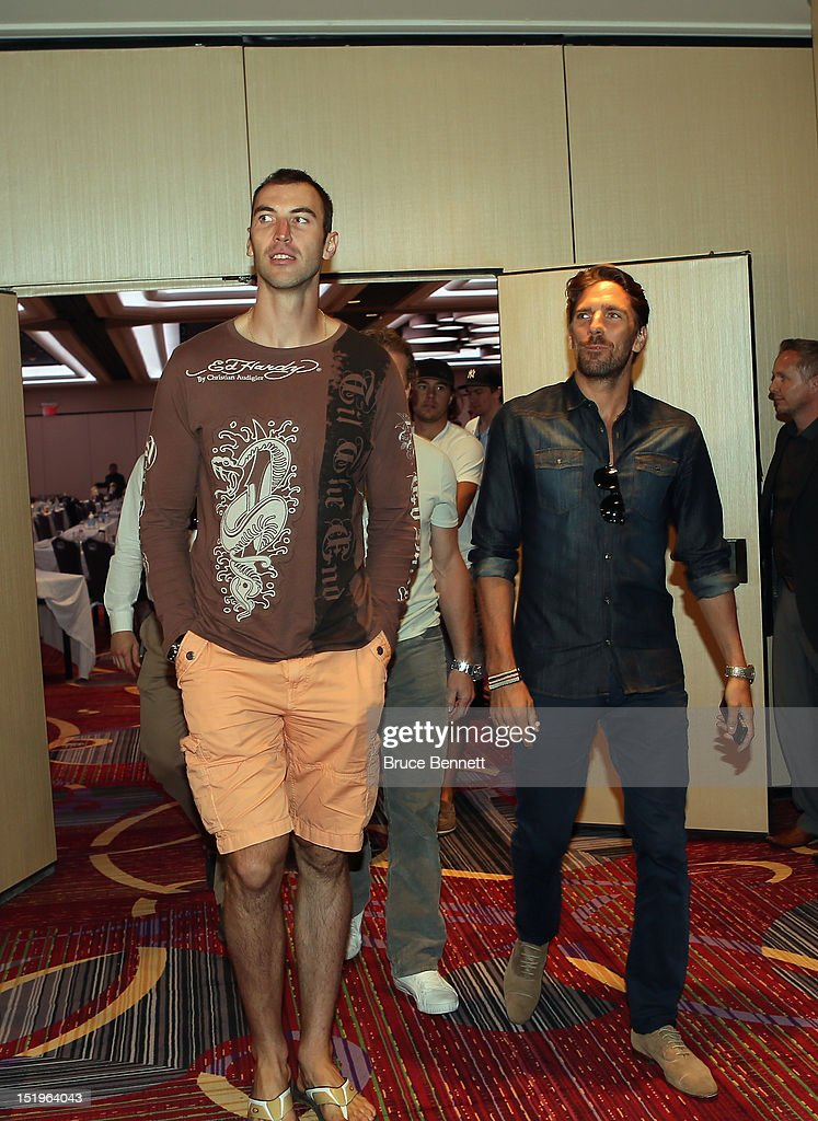 Zdeno Chara of the Boston Bruins and Henrik Lundqvist of the New York Rangers arrive for the NHLPA press conference at Marriott Marquis Times Square on September 13, 2012 in New York City.