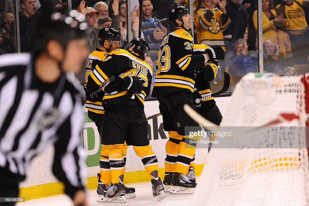 <a gi-track='captionPersonalityLinkClicked' href=/galleries/search?phrase=Zdeno+Chara&family=editorial&specificpeople=203177 ng-click='$event.stopPropagation()'>Zdeno Chara</a> #33 of the Boston Bruins and his teammates celebrate a goal against the Detroit Red Wings at the TD Garden on October 5, 2013 in Boston, Massachusetts.