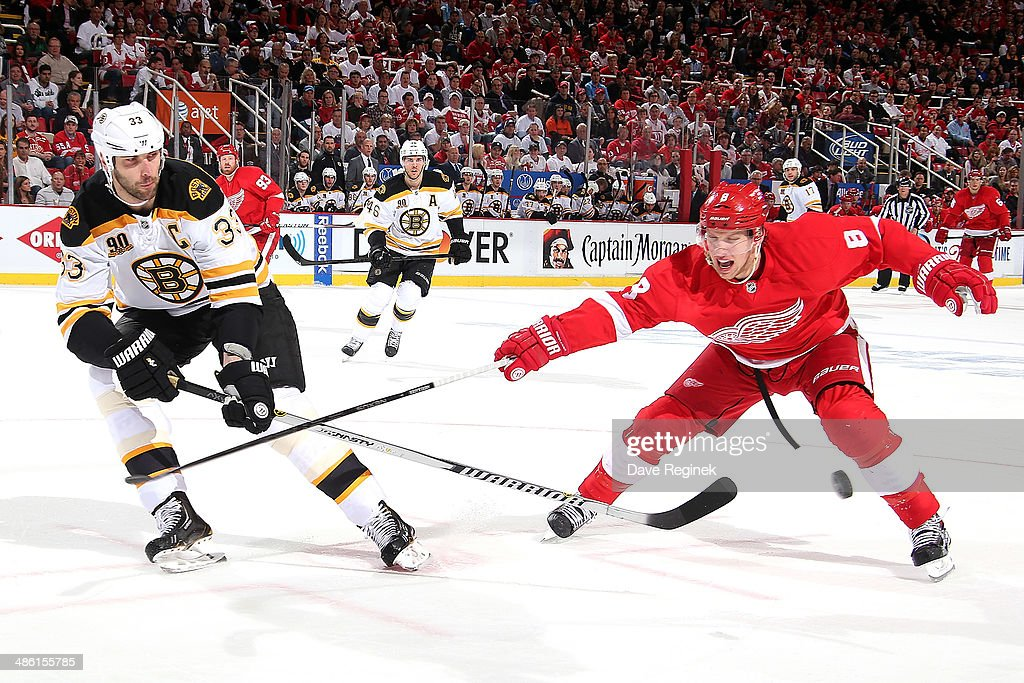 <a gi-track='captionPersonalityLinkClicked' href=/galleries/search?phrase=Zdeno+Chara&family=editorial&specificpeople=203177 ng-click='$event.stopPropagation()'>Zdeno Chara</a> #33 of the Boston Bruins and <a gi-track='captionPersonalityLinkClicked' href=/galleries/search?phrase=Justin+Abdelkader&family=editorial&specificpeople=2271858 ng-click='$event.stopPropagation()'>Justin Abdelkader</a> #8 of the Detroit Red Wings battle for the puck during Game Three of the First Round of the 2014 Stanley Cup Playoffs on April 22, 2014 at Joe Louis Arena in Detroit, Michigan.