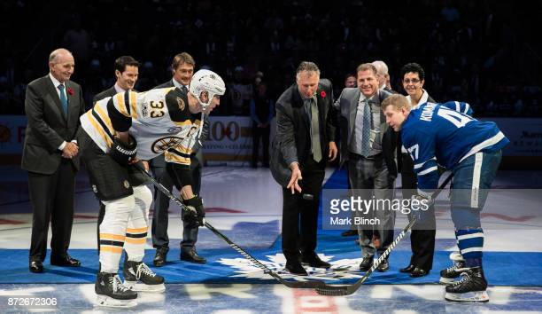 Zdeno Chara of the Boston Bruins and Leo Komarov of the Toronto Maple Leafs take the ceremonial face off with newly elected Hockey Hall of Fame...