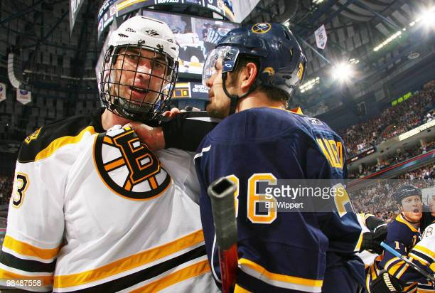 Zdeno Chara of the Boston Bruins and Patrick Kaleta of the Buffalo Sabres exchange words during a first period skirmish at Game One of the Eastern...