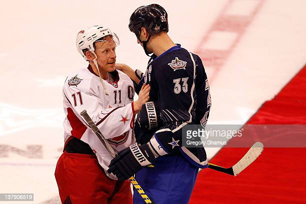 Zdeno Chara of the Boston Bruins and Team Chara talks with Daniel Alfredsson of the Ottawa Senators and Team Alfredsson after defeating Team...