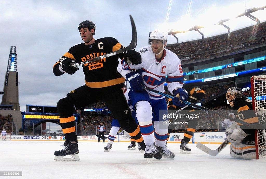 <a gi-track='captionPersonalityLinkClicked' href=/galleries/search?phrase=Zdeno+Chara&family=editorial&specificpeople=203177 ng-click='$event.stopPropagation()'>Zdeno Chara</a> #33 of the Boston Bruins battles for the puck against <a gi-track='captionPersonalityLinkClicked' href=/galleries/search?phrase=Max+Pacioretty&family=editorial&specificpeople=4324972 ng-click='$event.stopPropagation()'>Max Pacioretty</a> #67 of the Montreal Canadiens during the first period of the 2016 Bridgestone NHL Classic at Gillette Stadium on January 1, 2016 in Foxboro, Massachusetts.