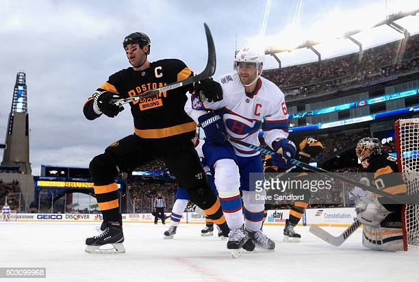Zdeno Chara of the Boston Bruins battles for the puck against Max Pacioretty of the Montreal Canadiens during the first period of the 2016...